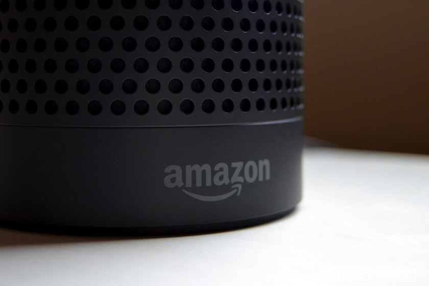 Amazon Echo with Amazon logo showing. The image is to show the difference between the Echo and Amazon Echo Plus.