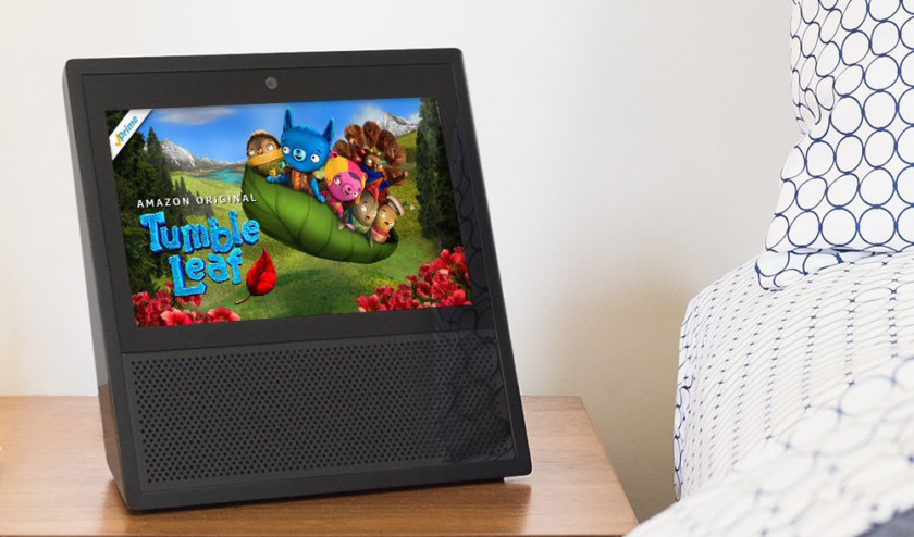 An image of an Amazon Echo Show on a night stand.