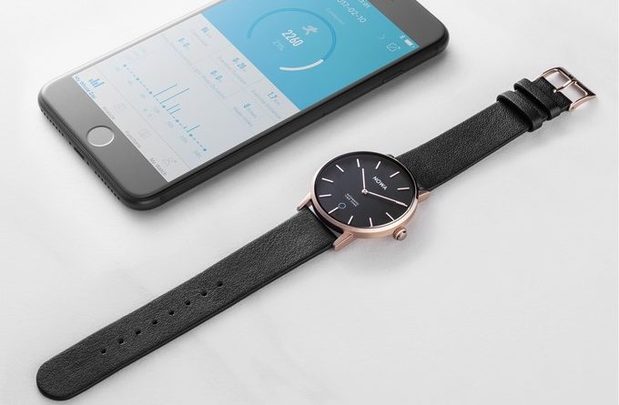 Nowa Shaper Hybrid Smart Watch next to smartphone