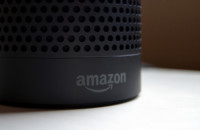 The Amazon logo on an Amazon Echo.