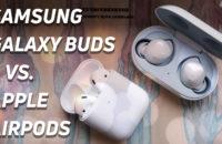 Samsung Galaxy Buds versus Apple's new AirPods (2019) top-down hero image.